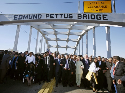US Senators Obama and Clinton cross a bridge during the re-enactment of Selma to Montgomery march in Alabama